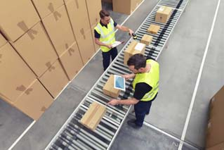 Worker in a warehouse in the logistics sector processing packages